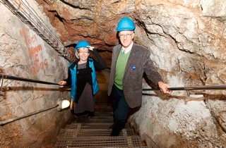 Simon Timms of HLF and Libby Buckley, Museum Director, explore the WW2 tunnels and escape steps