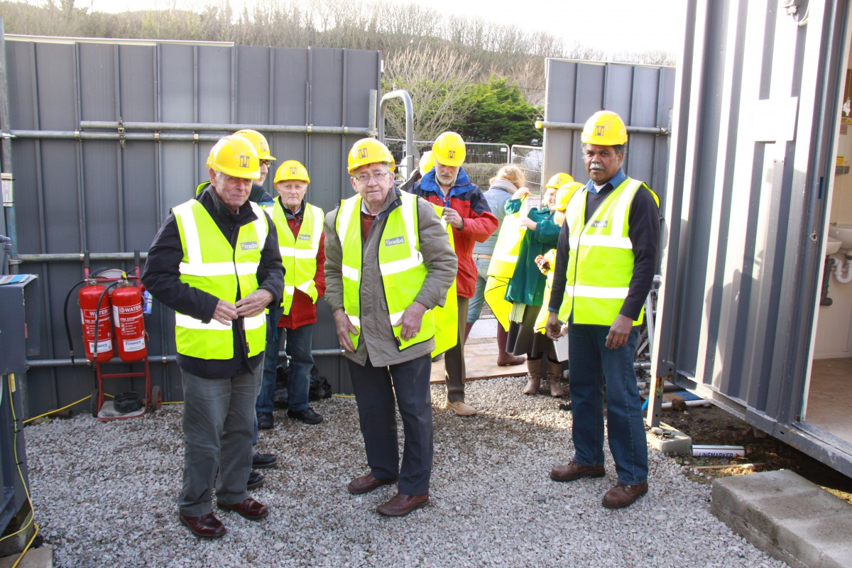 Museum volunteers and staff don hard hats and high-vis for their VIP site tour