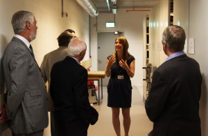 Collections Manager Charlotte Dando shows a group of guests around the new archive store.