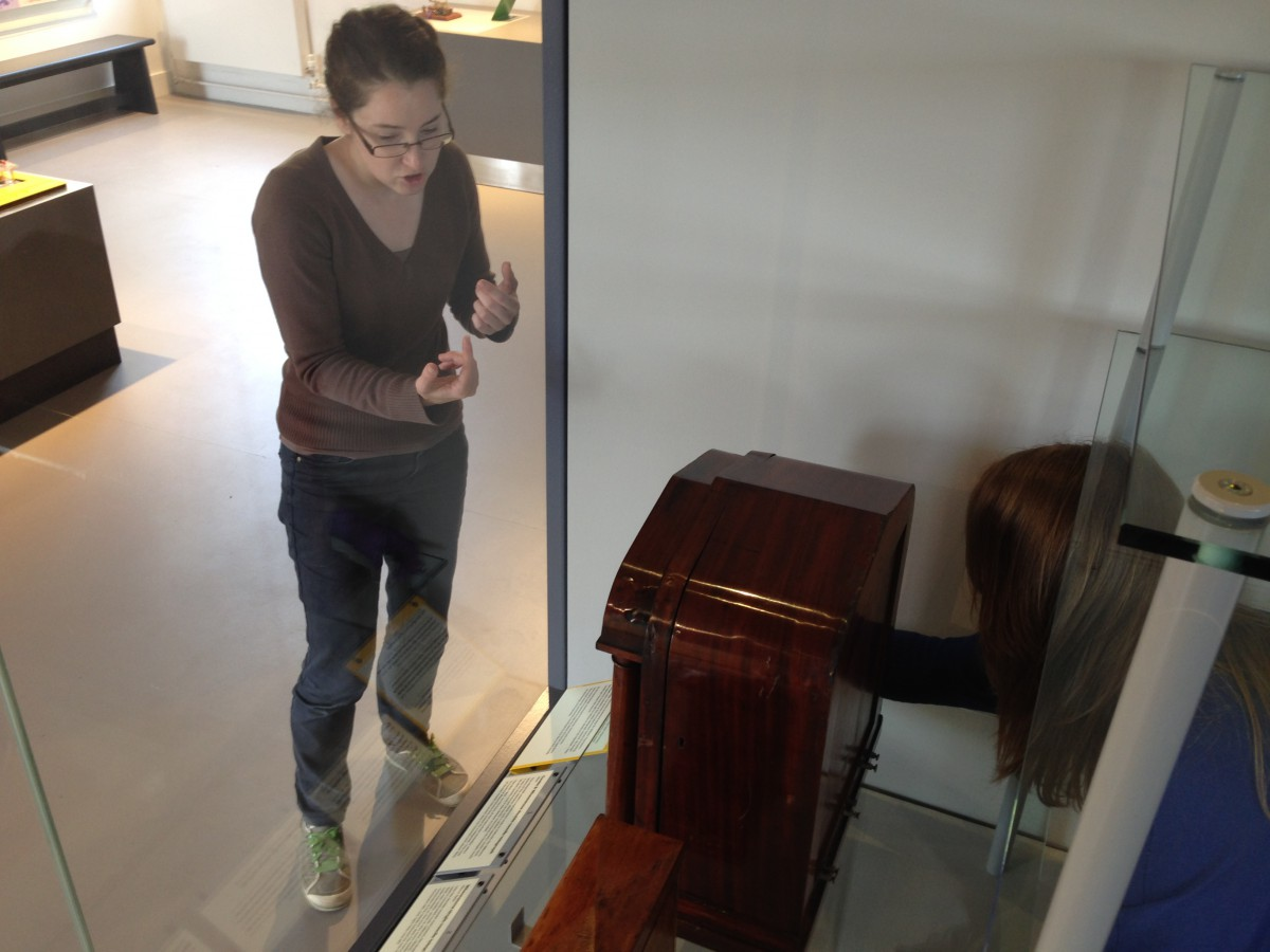 Achieving Perfection - Here Charlotte and Ros are finely adjusting the large technical display case in Eastern House