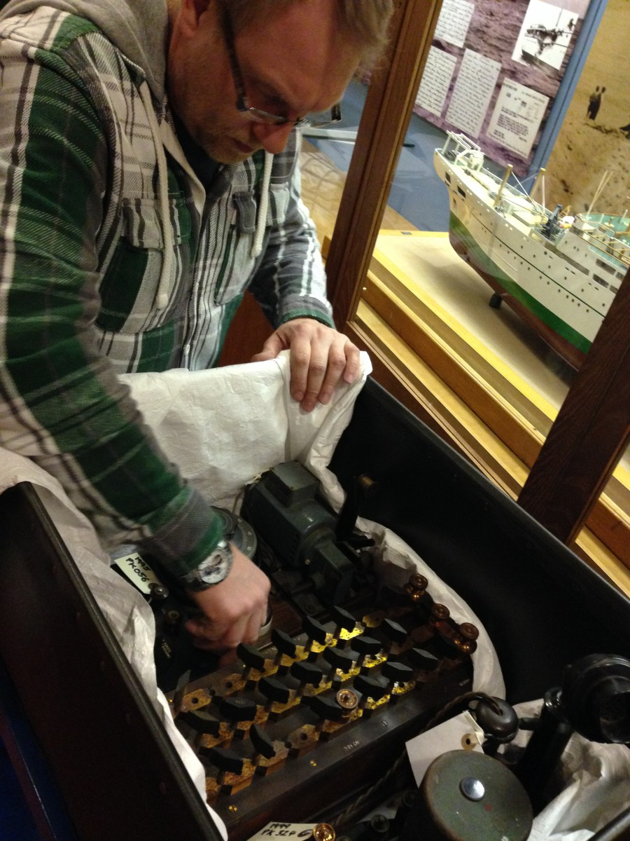 Tunnels Display Cases part 1 - Here is Tye carefully packing away items to transfer to the Object Store