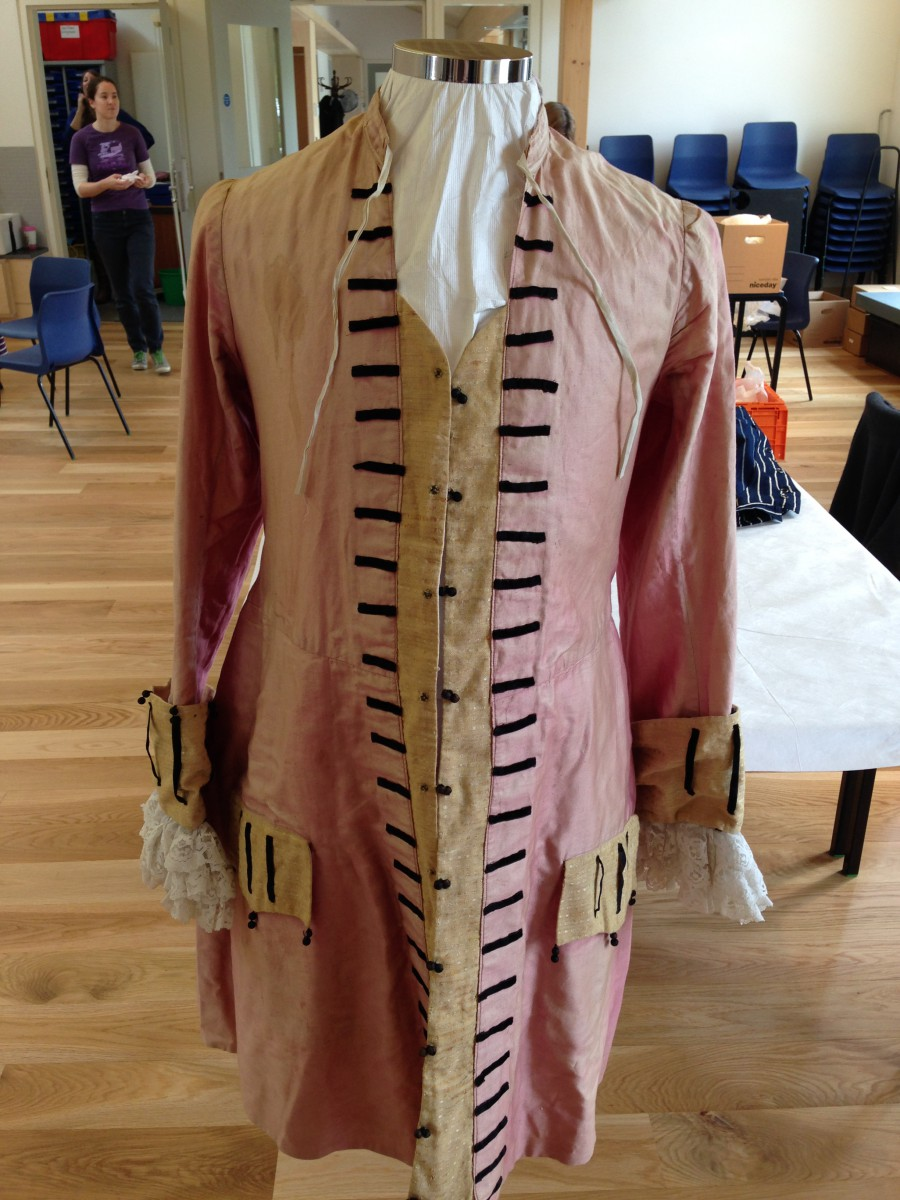 Displaying Textiles - Here we have mounted this wonderful fancy dress coat on a mannequin covered with Tyveck, which will protect the textile from harmful chemicals in the foam.