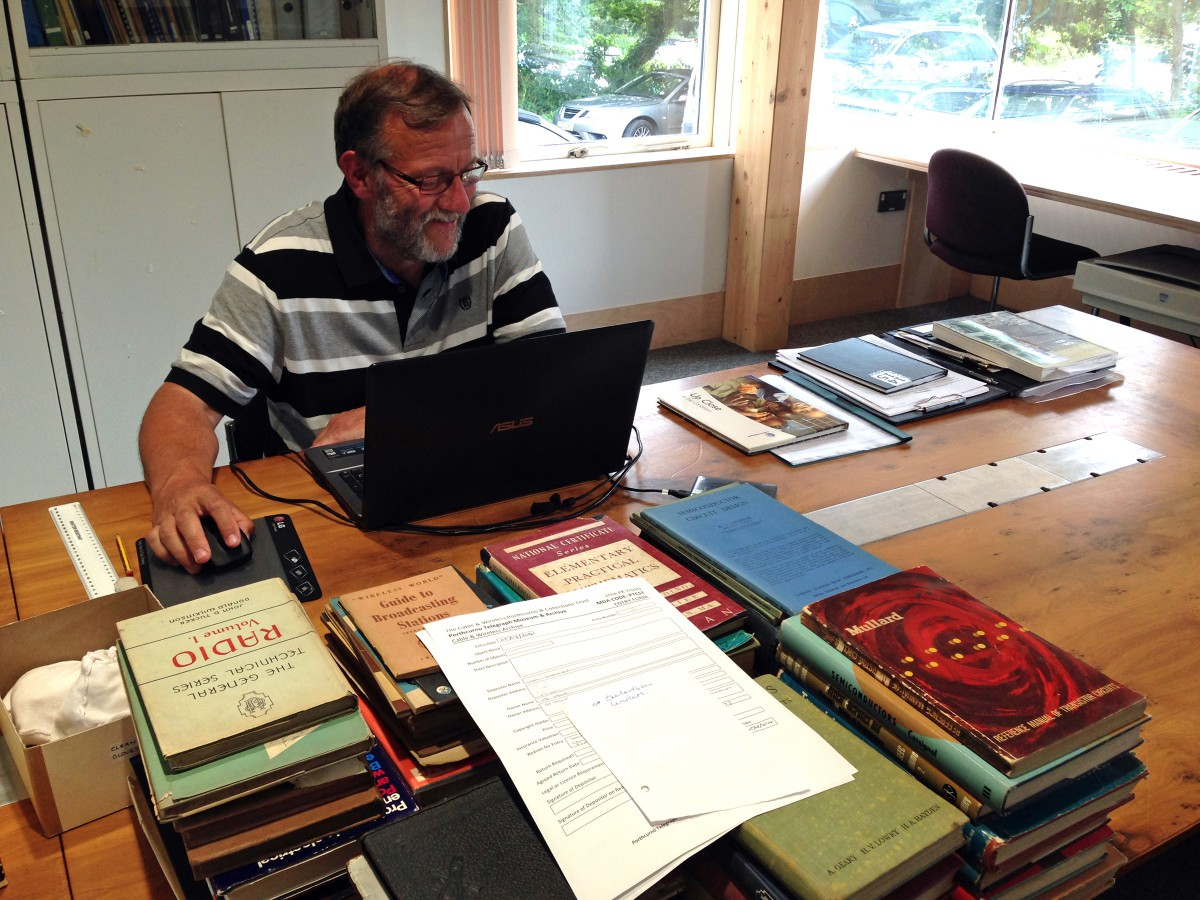 Archive Volunteer - John Wallis working through a new collection of documents for the Archive