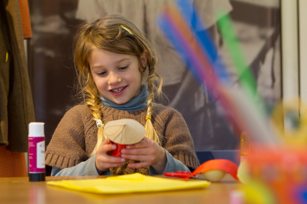 A young visitor enjoying a creative 'make and take' activity at the Telegraph Museum