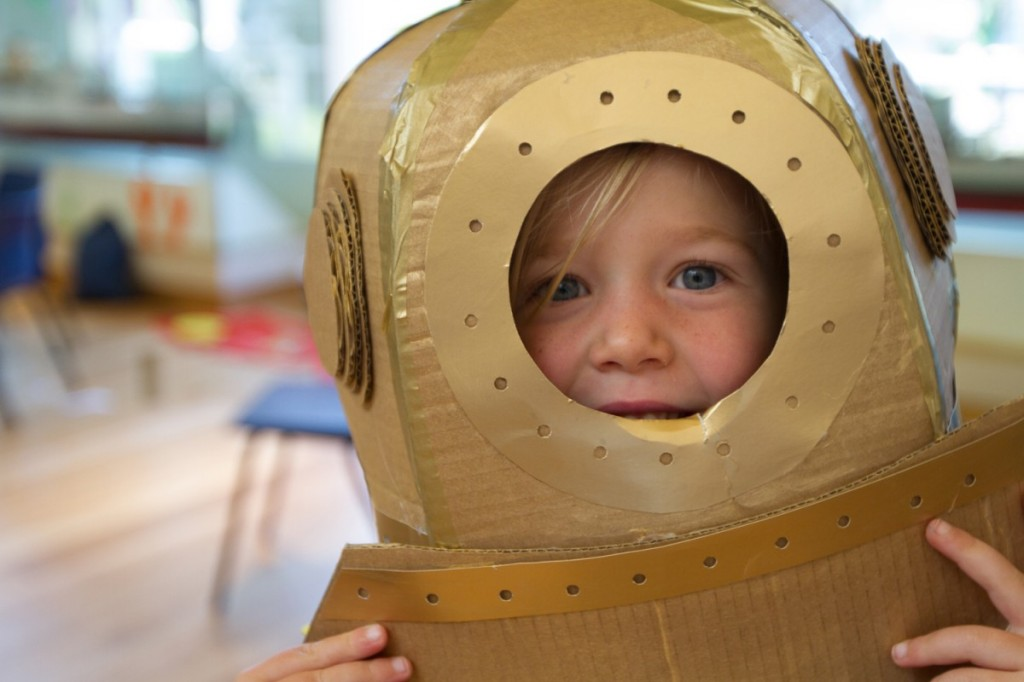 Young child wearing gold diving bell helmet