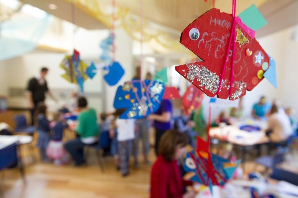 Sparkly fish decorations hang from the ceiling for a children's party