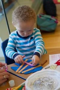 Little boy enjoys a craft activity in a children's party