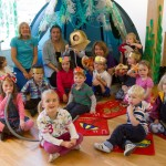 Children, parents and museum staff sat in a 'secret sea cave' for a children's party