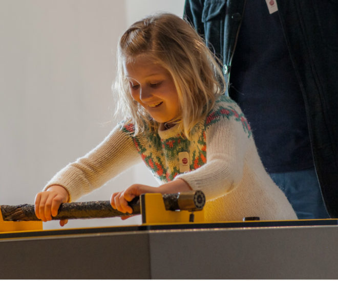 Photograph of a girl exploring submarine cables at the Telegraph Museum Porthcurno.