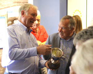 Photograph of Peter Burleigh and Gareth Parry enjoying a friendly conversation about the Exiles Golf Society Trophy.
