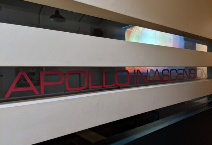 View of exhibition and Cable and Wireless commissioned film titled Apollo in Ascension, narrated by actor Julian Glover from Game of Thrones and Star Wars.