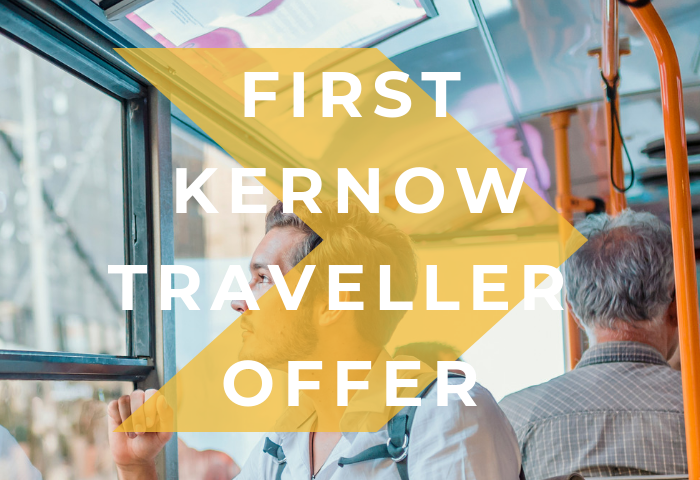 Colour photograph showing light and airy view of holiday travellers on a bus, with bright yellow arrow and white text that reads First Kernow traveller offer, for Telegraph Museum Porthcurno visitor discount of 50% off museum entry for bus users in Cornwall.