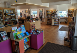 Colour photograph showing Telegraph Museum Porthcurno shop, with gifts, books, toys, ice cream, jewellery and more.