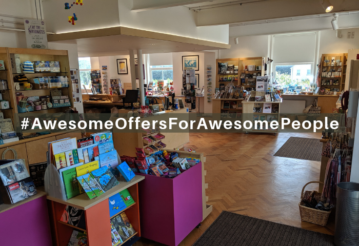 Colour photograph showing the exciting shop at the Telegraph Museum Porthcurno with white text which reads awesome offers for awesome people written as #AwesomeOffersForAwesomePeople.