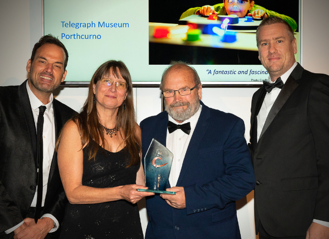 Photograph taken at Cornwall Tourism Award ceremony 2019 held at Truro Cathedral featuring representatives from CATA and Seymac Distribution, Cornwall, with staff from the Telegraph Museum Porthcurno receiving a silver award for Small Visitor Attraction of the Year.