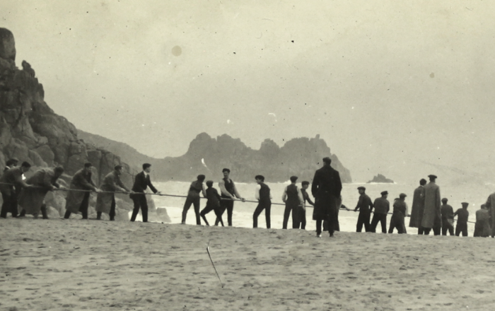 Archive photograph of landing a undersea cable onto the beach at Porthcurno.