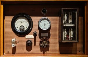 Electrical dials, gauges set in wooden panel